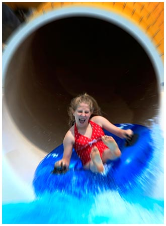 Kid Going Down a Slide.jpg